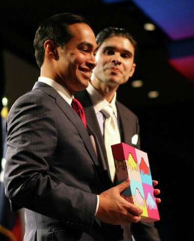 San Antonio Mayor Julián Castro is presented with a piece of artwork by Andy Tiwari that the Chamber of Commerce created internally for the mayor after Castro presented his annual State of the City address on Feb. 26, 2013. Officials with the Chamber say the piece is inspired by the mayor's mission, vision and leadership. Photo: Cynthia Esparza, San Antonio Express-News / ©2013 San Antonio Express-News