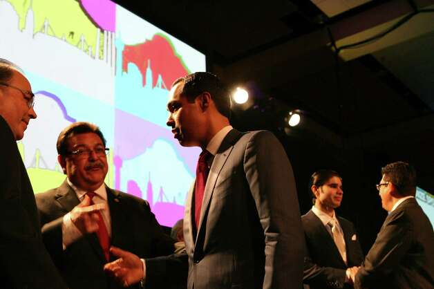 San Antonio Mayor Julián Castro speaks on Feb. 26, 2013, with Hispanic Chamber of Commerce president and CEO Ramiro Cavazos (left) and Hispanic Chamber of Commerce chairman of the board Alex Briseno after Castro presented his annual State of the City address at the Henry B. Gonzalez Convention Center in San Antonio. Photo: Cynthia Esparza, San Antonio Express-News / ©2013 San Antonio Express-News
