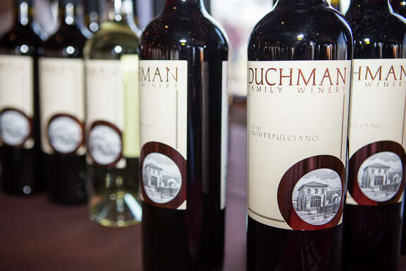 FOR TASTE - Duchman wines, based in Texas, are shown during a Cowboys + Gauchos event at the Salt Lick in Driftwood on Sunday, Feb. 24, 2013. The event was hosted by the Wine & Food Foundation of Texas, and will showcase the similarities between Texas and South American style BBQ. MICHAEL MILLER / FOR THE EXPRESS-NEWS