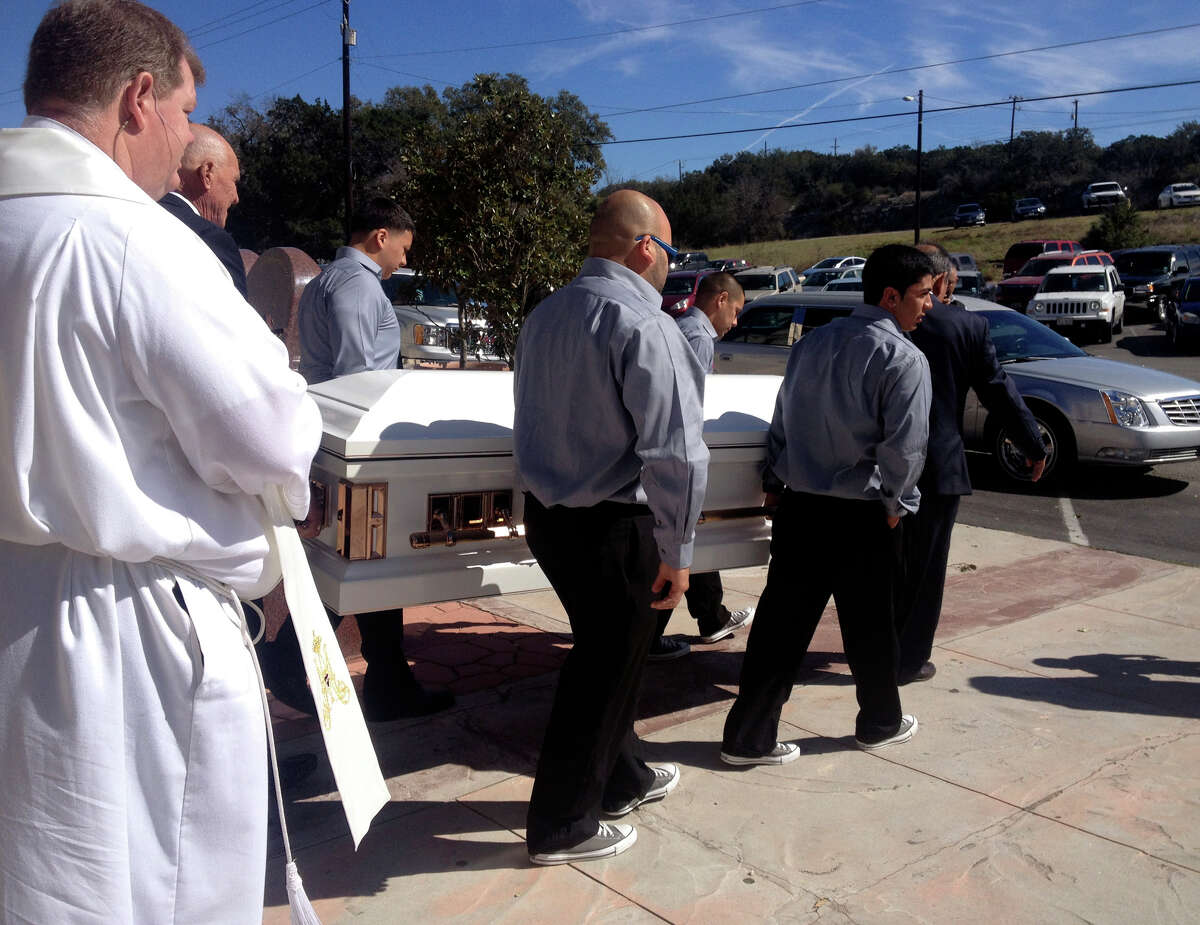 Pallbearers carry the casket of Gina Rodriguez out of Our Lady of Guadalupe Catholic Church after her funeral Mass Tuesday morning. Rodriguez died from her injuries after a car accident on Feb. 19.