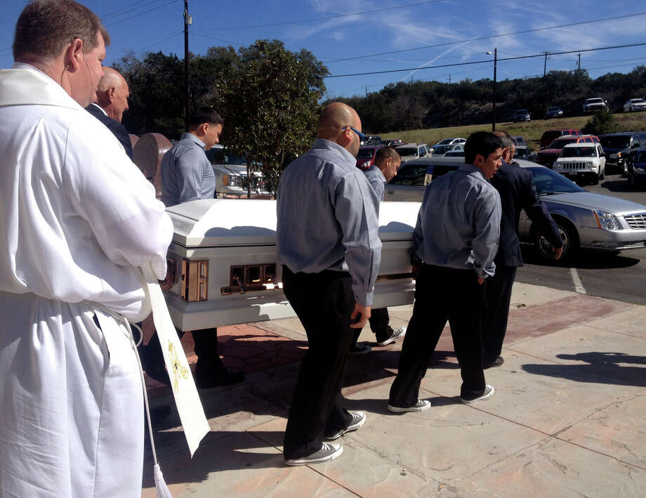 Pallbearers carry the casket of Gina Rodriguez out of Our Lady of Guadalupe Catholic Church after her funeral Mass Tuesday morning. Rodriguez died from her injuries after a car accident on Feb. 19. Photo: Sarah Tressler/Express-News