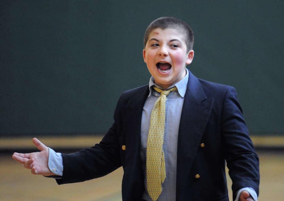 Eastern Middle School eighth-grader Blake Guerrieri, 13, reacts while coaching a team of eighth-graders during the student/faculty basketball game to raise money for the Sandy Hook Elementary School physical education department held in the gym at the school in Riverside, Tuesday afternoon, Feb. 26, 2013. According to Craig Knop, a physical education teacher at the school, who lives in Newtown, the organziers of the event hoped to raise $4,000. The teachers won the game 29-28. Photo: Bob Luckey / Greenwich Time