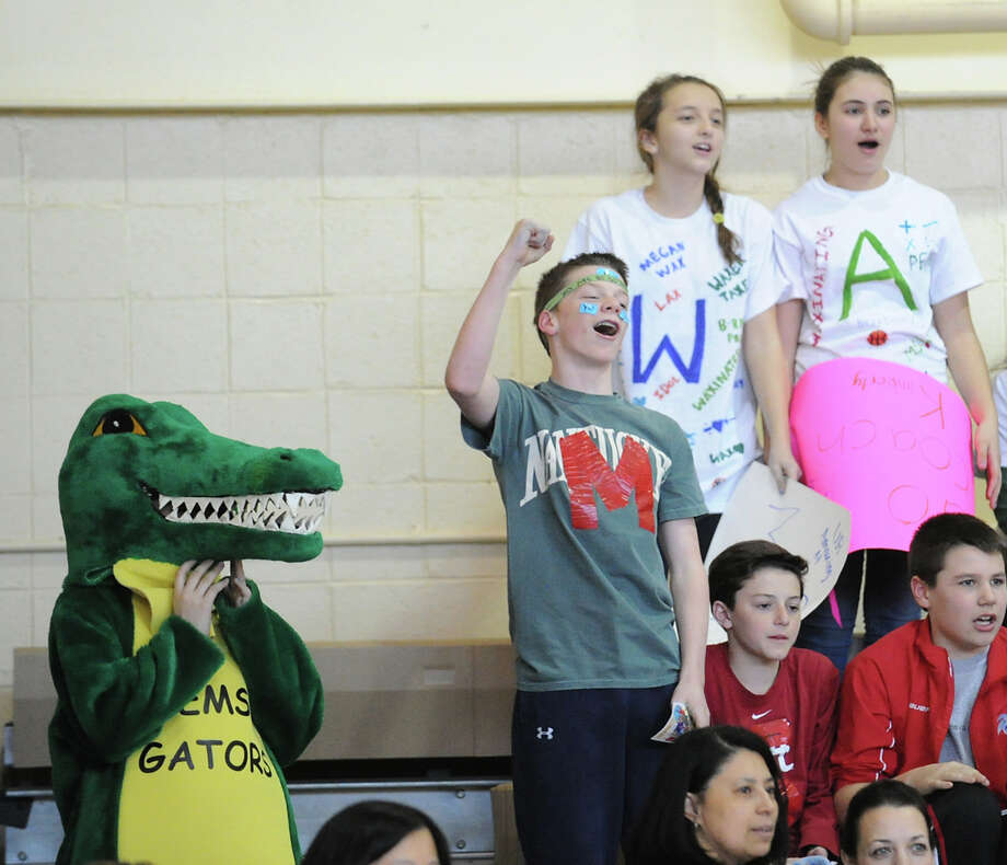 The Eastern Middle School student/faculty basketball game to raise money for the Sandy Hook Elementary School physical education department held in the gym at the school in Riverside, Tuesday afternoon, Feb. 26, 2013. According to Craig Knop, a physical education teacher at the school, who lives in Newtown, the organziers of the event hoped to raise $4,000. The teachers won the game 29-28. Photo: Bob Luckey / Greenwich Time