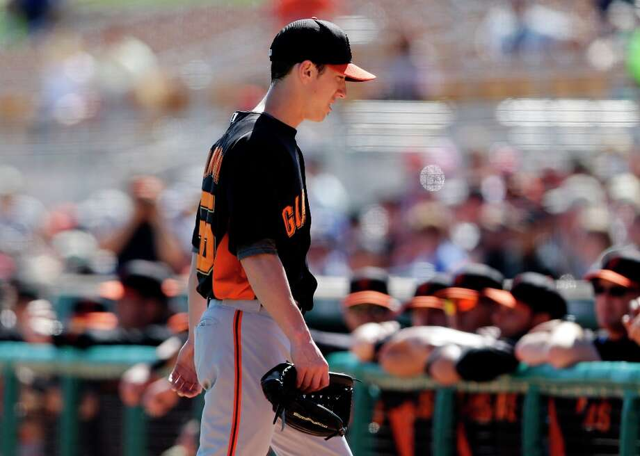 San Francisco Giants starting pitcher Tim Lincecum walks to the dugout after being pulled from the game against the Los Angeles Dodgers during the second inning of an exhibition spring training baseball game on Tuesday, Feb. 26, 2013 in Glendale. Ariz. (AP Photo/Marcio Jose Sanchez) Photo: Marcio Jose Sanchez, Associated Press / AP