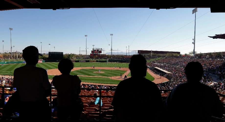 Fans watch an exhibition spring training baseball game game between the San Francisco Giants and the Los Angeles Dodgers during the sixth inning on Tuesday, Feb. 26, 2013 in Glendale. Ariz. (AP Photo/Marcio Jose Sanchez) Photo: Marcio Jose Sanchez, Associated Press / AP