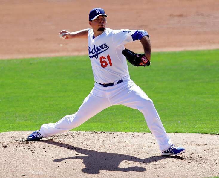 Los Angeles Dodgers starting pitcher Josh Beckett throws against the San Francisco Giants during the