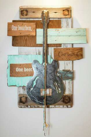 One of Pen Morrison's wood and metal guitar collages at her home, Wednesday, Feb. 20, 2013, in Houston.  Morrison is a Houston-based artist who creates pieces as tributes to various guitarists and is displaying her art in an upcoming show at Cactus Music.  ( Michael Paulsen / Houston Chronicle ) Photo: Michael Paulsen, Staff / © 2013 Houston Chronicle