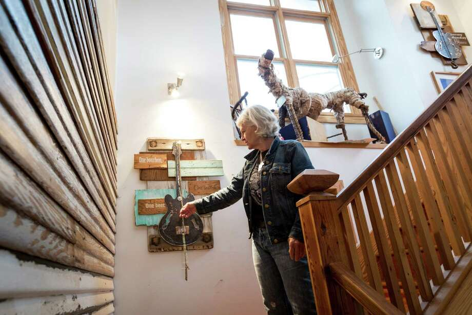 Pen Morrison and her wood and metal guitar collages at her home, Wednesday, Feb. 20, 2013, in Houston.  Morrison is a Houston-based artist who creates pieces as tributes to various guitarists and is displaying her art in an upcoming show at Cactus Music.  ( Michael Paulsen / Houston Chronicle ) Photo: Michael Paulsen, Staff / © 2013 Houston Chronicle