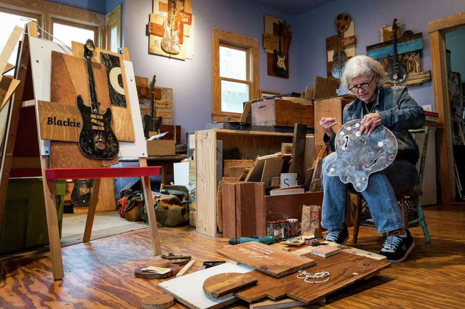 Pen Morrison uses discarded wood to create her mixed-media collages. Nothing is random in her art - even the guitars are shaped like the models used by the artists to whom they pay tribute. Photo: Michael Paulsen, Staff / © 2013 Houston Chronicle