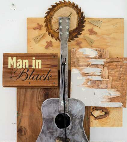 A Johnny Cash tribute includes a circle-saw blade, referencing the death of Cash's brother, an event that influenced his songs. Photo: Michael Paulsen, Staff / © 2013 Houston Chronicle