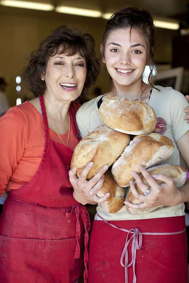 Casse-Croute's owner Lenore Colarusso-Denoix with employee Nina  Kassardjian, move loaves of bread at the popular new bakery in  Livermore. Photo: Jason Henry, Special To The Chronicle