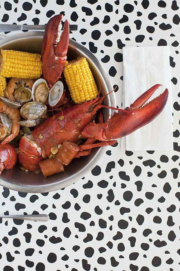 Having the seafood boil could be a messy business at Voodoo Kitchen in Pleasanton, but it very well might be worth it - to release your inner shark. Photo: Jason Henry, Special To The Chronicle