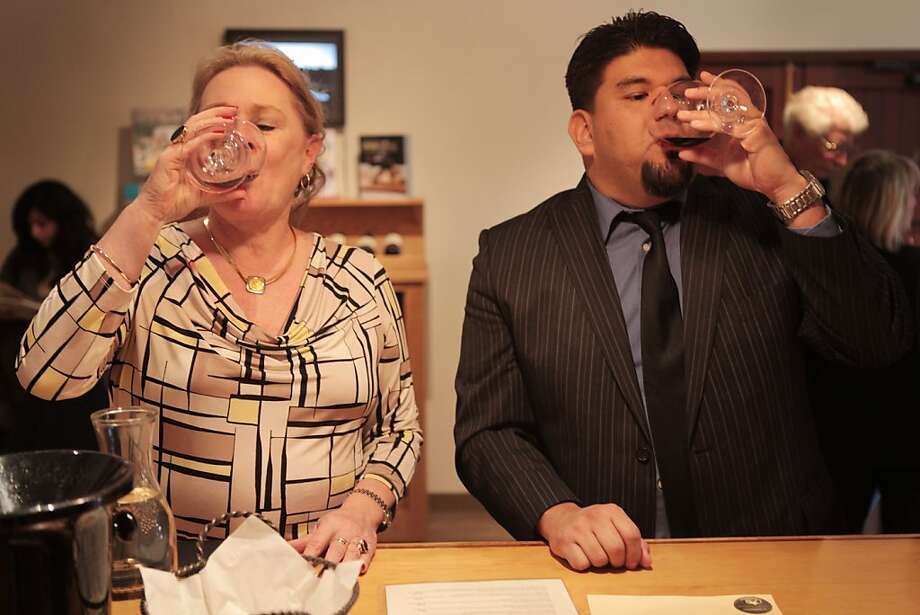 Maureen Kane and Gabriel Chavez sample wine in the tasting room at Wente Vineyards. Photo: Pete Kiehart, The Chronicle