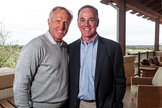 Famed golfer Greg Norman (left) and Valero President and Chief Operating Officer Joe Gorder outside the clubhouse at TPC San Antonio on Tuesday, Feb. 26, 2013.  The two, along with tournament director Larson Segerdahl, fielded questions and announced early player commitments for the 2013 Valero Texas Open scheduled for April 1-7 at the TPC-San Antonio AT&T Oaks Course. Photo: Marvin Pfeiffer, San Antonio Express-News / Express-News 2013