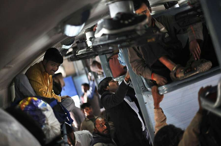 Indians settle inside an overcrowded train in New Delhi, India, Tuesday, Feb. 26, 2013. Indian Railw