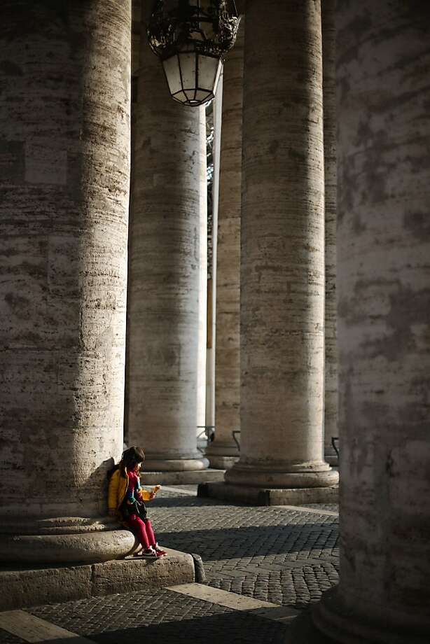 VATICAN CITY, VATICAN - FEBRUARY 26:  A child sits under The Colonnade on February 26, 2013 in Vatican City, Vatican. The Pontiff will hold his last weekly public audience on February 27, 2013 before he retires the following day. Pope Benedict XVI has been the leader of the Catholic Church for eight years and is the first Pope to retire since 1415. He cites ailing health as his reason for retirement and will spend the rest of his life in solitude away from public engagements  (Photo by Peter Macdiarmid/Getty Images)  *** BESTPIX *** Photo: Peter Macdiarmid, Getty Images