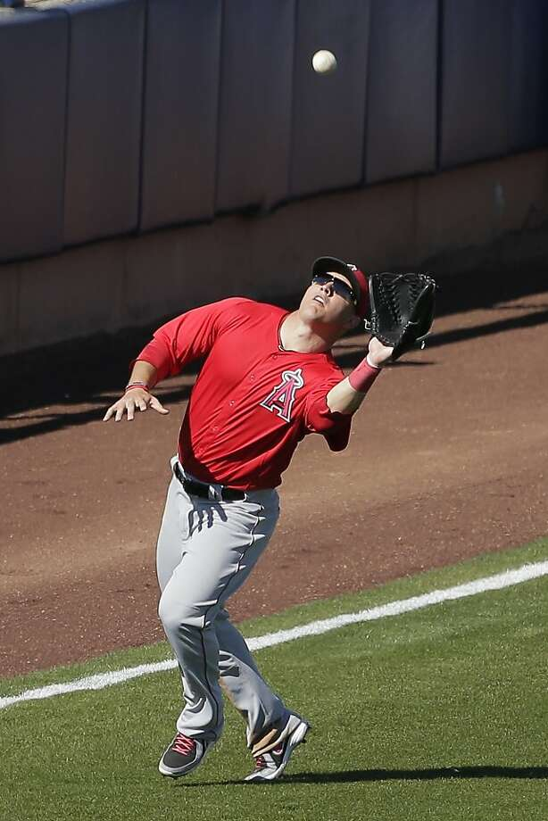 Angels center fielder Mike Trout's goal is to lose 10 pounds by Opening Day - manager Mike Scioscia isn't worried. Photo: Charlie Riedel, Associated Press