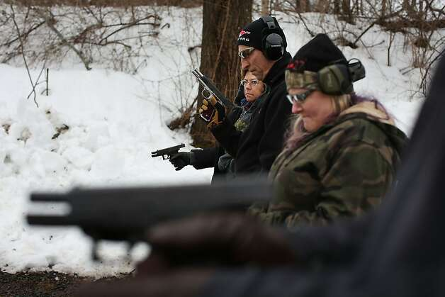 WALLINGFORD, CT - FEBRUARY 24:  Students learn to fire their pistols at a class taught by King 33 Training at a shooting range on February 24, 2013 in Wallingford, Connecticut. King 33 Training, a company that trains and educates individuals on the safe and proper use of guns and other uses of protective force, offers classes to marksmen of all levels. The Connecticut company offers training for clients interested in maintaining a safe environment for themselves, their families, and those around them. Connecticut, home to a number of gun manufactures including Colt Defense, is a state with conflicting views on guns and gun ownership. Currently the state has some of the strictest gun control laws in the nation and its current governor Daniel Malloy is pushing for tougher measures following the shootings at the Sandy Hook School. (Photo by Spencer Platt/Getty Images) Photo: Spencer Platt, Getty Images