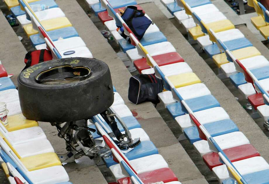 A wheel, tire and suspension parts sit in the stands after crash on the final lap of the NASCAR Nationwide Series auto race Saturday, Feb. 23, 2013, at Daytona International Speedway in Daytona Beach, Fla. Several fans were injured when large chunks of debris sailed into the grandstands after a car flew into the fence. (AP Photo/David Graham) Photo: David Graham