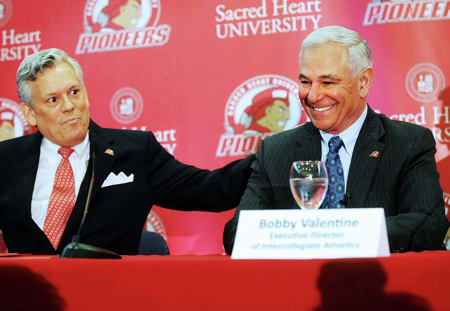 Senior Vice President of Athletics and Student Affairs James Barquinero, left, introduces Bobby Valentine during news conference at Sacred Heart University in Fairfield, Conn., Tuesday, Feb. 26, 2013. Valentine has been named executive director of Intercollegiate Athletics at Sacred Heart. (AP Photo/The Connecticut Post, Brian A. Pounds) MANDATORY CREDIT Photo: Brian A. Pounds