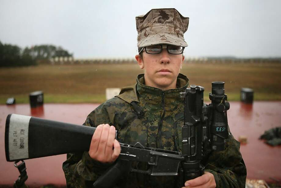 PARRIS ISLAND, SC - FEBRUARY 25:  Marine recruit Melony Couture waits for her rifle to be inspected before firing on the rifle range during boot camp February 25, 2013 at MCRD Parris Island, South Carolina. Female enlisted Marines have gone through recruit training at the base since 1949. About 11 percent of female recruits who arrive at the boot camp fail to complete the training, which can be physically and mentally demanding. Females in the Marines and other branches of the armed forces have been forbidden from being assigned to ground combat units since 1994. On January 24, 2013 Secretary of Defense Leon Panetta rescinded that order.  (Photo by Scott Olson/Getty Images) Photo: Scott Olson, Getty Images