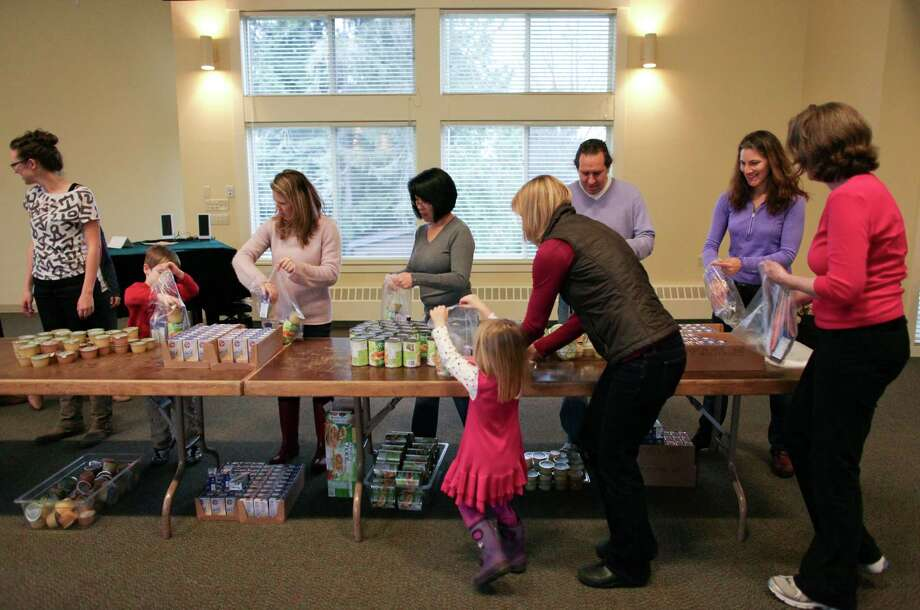 People pack food during a Healthy HIP Packs packing party. Photo: JOSHUA TRUJILLO / SEATTLEPI.COM