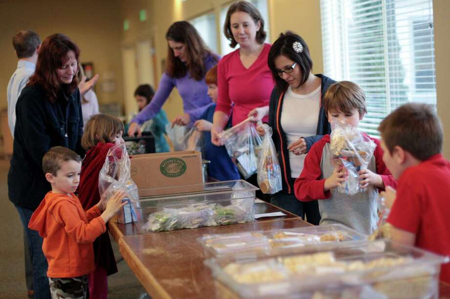 Volunteers pack food during a Healthy HIP Packs packing party. Photo: JOSHUA TRUJILLO / SEATTLEPI.COM