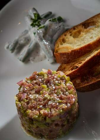 The lamb tartare has a hint of mint, a bit more whole-grain mustard and Moroccan argan oil. Photo: John Storey