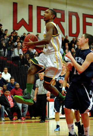 Trinity Catholic's #3 Tremaine Frasier starts a layup, during FCIAC boys basketball semifinals action against Wilton in Fairfield, Conn. on Tuesday February 26, 2013. Photo: Christian Abraham / Connecticut Post