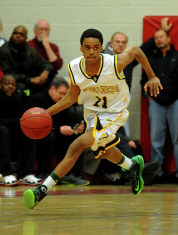 Trinity Catholic's #11 Justice Page drives the ball, during FCIAC boys basketball semifinals action against Wilton in Fairfield, Conn. on Tuesday February 26, 2013. Photo: Christian Abraham / Connecticut Post