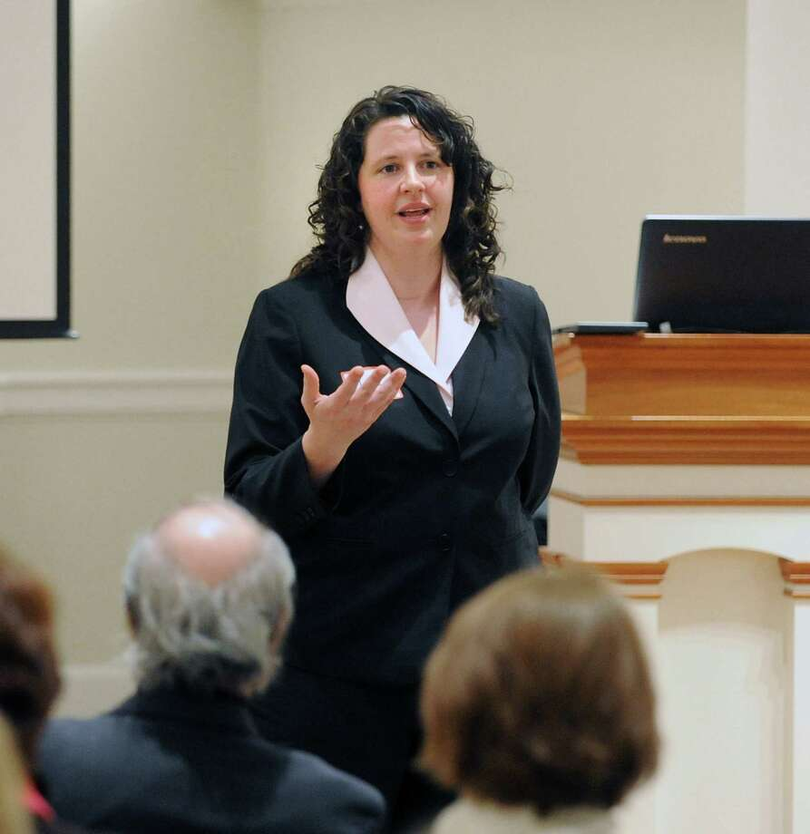 Liz Perry of Greenwich, founder of the Greenwich Council on Gun Violence, speaks during the Stand Against Violence Effectively community forum at the First Presbyterian Church in Greenwich, Tuesday night, Feb. 26, 2013. The Sandy Hook Elementary School shooting was discussed at the forum that was sponsored by the Greenwich Council on Gun Violence and the Interfaith Council of Southwestern Connecticut. Photo: Bob Luckey / Greenwich Time