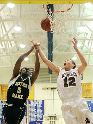 Notre Dame Fairfield's Earl Coleman (5) battles for a rebound with Bethel's Matthew Liquori (12) during Bethel's 75-67 win over Notre Dame Fairfield in the semifinal game of the South-West Conference Boy's High School Basketball Tournament at Newtown High School in Newtown, Conn. on Tuesday, Feb. 26, 2013. Photo: Tyler Sizemore / The News-Times