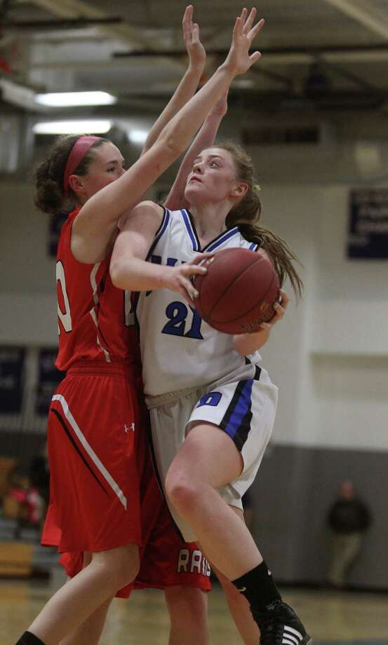 Darien basketball player Meg Marren eyes the hoop as she drives against a Cheshire opponent during CIAC basketball action in Darien on Tuesday evening. Darien led throughout, winning 56-50 to advance to the next round.© J. Gregory Raymond for The Advocate Photo: J. Gregory Raymond / Stamford Advocate Freelance;  © J. Gregory Raymond