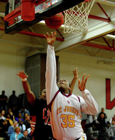 St. Joseph's #35 Erick Langston releases a shot, during FCIAC boys basketball semifinals action against Central in Fairfield, Conn. on Tuesday February 26, 2013. Photo: Christian Abraham / Connecticut Post