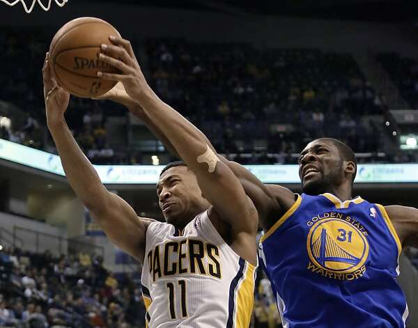 Indiana Pacers guard Orlando Johnson, left, pulls down a rebound in front of Golden State Warriors center Festus Ezeli during the first half of an NBA basketball game in Indianapolis, Tuesday, Feb. 26, 2013. (AP Photo/AJ Mast) Photo: Aj Mast, Associated Press