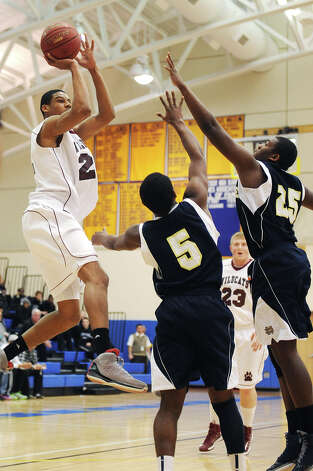 Bethel's Daniel Garvin shoots over Notre Dame Fairfield defenders Earl Coleman (5) and Kevin Laing (25) during Bethel's 75-67 win over Notre Dame Fairfield in the semifinal game of the South-West Conference Boys High School Basketball Tournament at Newtown High School in Newtown, Conn. on Tuesday, Feb. 26, 2013. Garvin led Bethel with with 30 points, 23 rebounds and seven blocks. Photo: Tyler Sizemore / The News-Times
