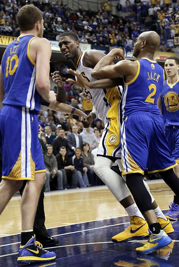 The Warriors' Jarrett Jack tries to keep Roy Hibbert from attacking David Lee. Photo: AJ Mast, Associated Press