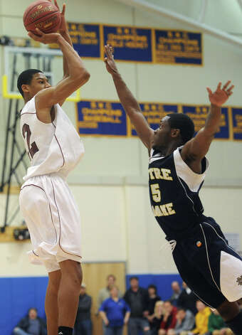 Bethel's Daniel Garvin shoots over Notre Dame Fairfield defender Earl Coleman (5) during Bethel's 75-67 win over Notre Dame Fairfield in the semifinal game of the South-West Conference Boys High School Basketball Tournament at Newtown High School in Newtown, Conn. on Tuesday, Feb. 26, 2013. Garvin led Bethel with with 30 points, 23 rebounds and seven blocks. Photo: Tyler Sizemore / The News-Times
