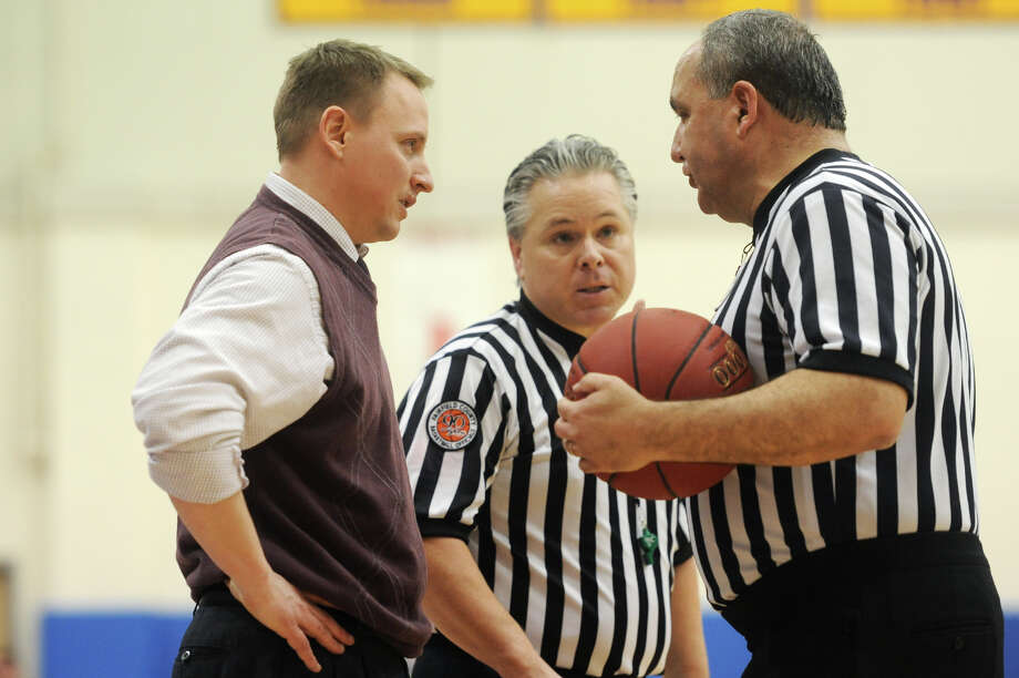Bethel head coach Ray Turek talks with officials during Bethel's 75-67 win over Notre Dame Fairfield in the semifinal game of the South-West Conference Boys High School Basketball Tournament at Newtown High School in Newtown, Conn. on Tuesday, Feb. 26, 2013. Photo: Tyler Sizemore / The News-Times