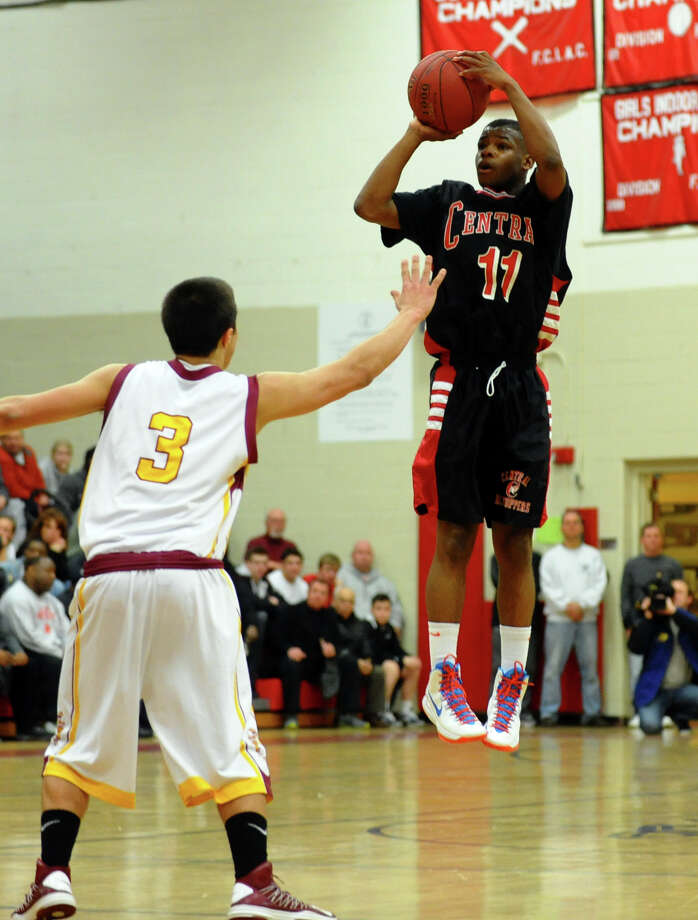 Central's #11 Tyler Ancrum looks to score, during FCIAC boys basketball semifinals action against St. Joseph in Fairfield, Conn. on Tuesday February 26, 2013. Photo: Christian Abraham / Connecticut Post