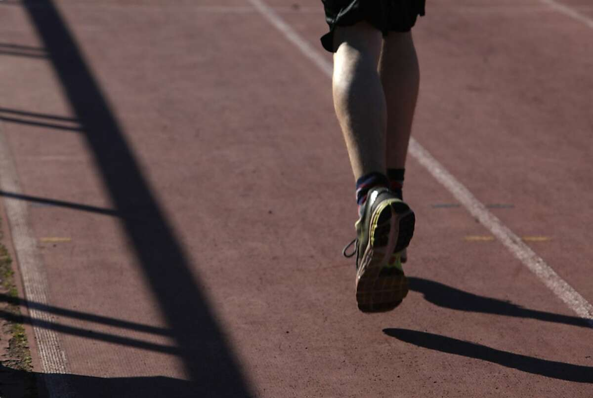 Scuff marks are seen in a lane on the running track at Kezar Stadium as a the Urban School of San Francisco Track team practices on it on Tuesday, February 26, 2013 in San Francisco, Calif.