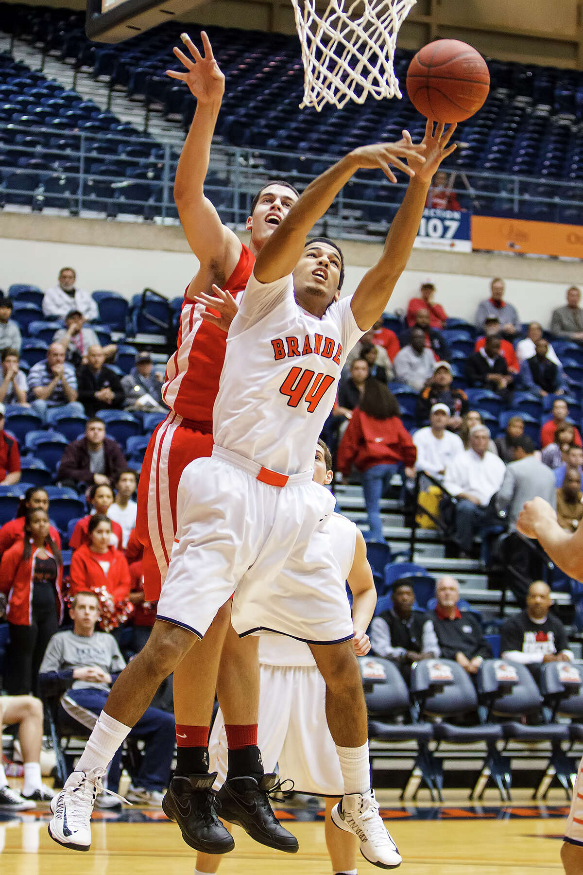Brandeis' Jonathan Robinson (right) battles Judson's David Wacker for a rebound during the first half of their Class 5A boys basketball third round game at the UTSA Convocation Center on Tuesday, Feb. 26, 2013. Brandeis won the game 60-53.