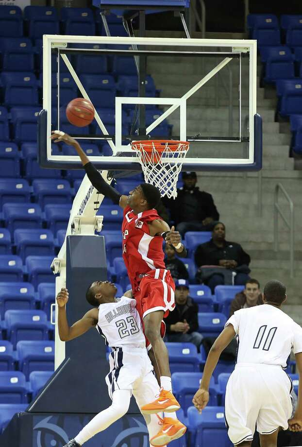 Mike Ross Connecticut Post freelance -Fairfield Prep's #44 Paschal Chukwu rejects Hillhouse's #23 Raiquan Clark shot at the basket during Tuesday evening SCC championship game.  Hillhouse would win 53-47. Photo: Mike Ross / www.mikerossphoto.com