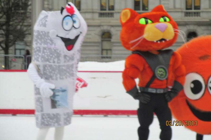 Lyn Forezzi Scoop with other mascots at the Empire State Plaza plaza ice rink
