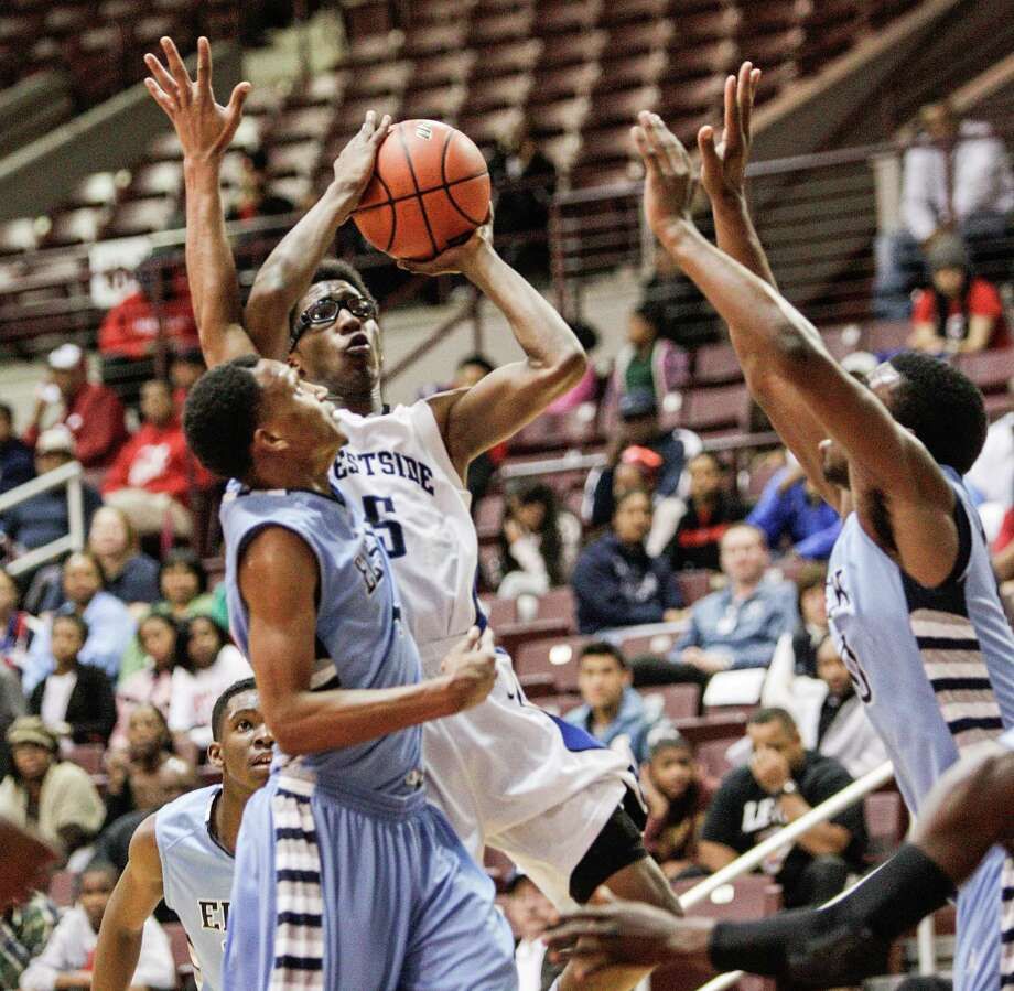 Westside's guard Robert Hatter, IV (5) drives the lane against Elsik during a Class 5A Region III quarterfinal basketball game Tuesday, February 26, 2013 at the M.O. Campbell Center in Houston. Westside wins 73-66 in overtime. Photo: Bob Levey, Houston Chronicle / ©2013 Bob Levey