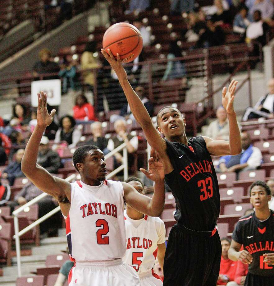 Bellaire's Josh Wall #33 drives to the basket past Alief Taylor's Martin Barronduring a Class 5A Region III quarterfinal basketball game Tuesday, February 26, 2013 at the M.O. Campbell Center in Houston. Photo: Bob Levey, Houston Chronicle / ©2013 Bob Levey