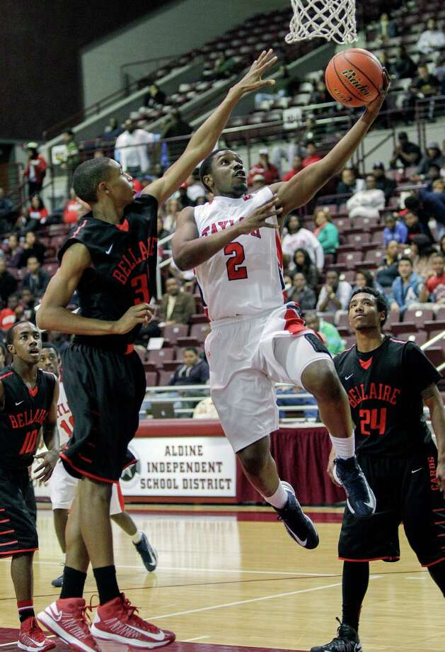 Alief Taylor's Martin Barron #2 drives past during a Class 5A Region III quarterfinal basketball game Tuesday, February 26, 2013 at the M.O. Campbell Center in Houston. Photo: Bob Levey, Houston Chronicle / ©2013 Bob Levey