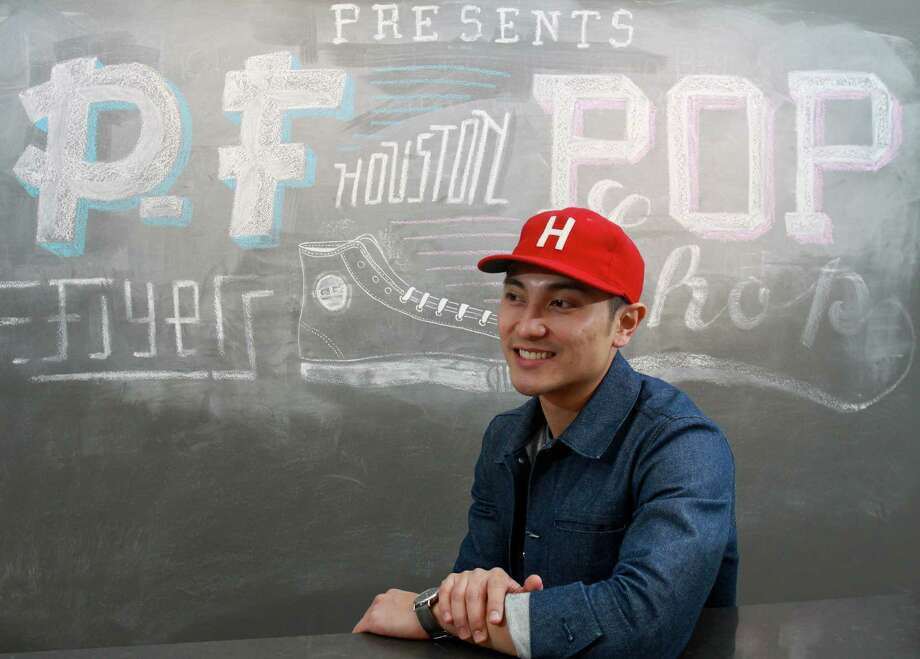 Jon Caballero is co-owner of The Class Room, with its PF Flyers pop-up shop chalkboard art display. The store held a kickoff party, featuring Mos Def, as a promotion for a temporary display for the shoe brand. Photo: Gary Fountain, Freelance / Copyright 2013 Gary Fountain.
