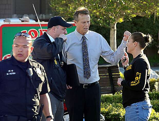 Santa Cruz County District Attorney Bob Lee confers with  members of the Sheriff's Department near the shooting scene in Santa Cruz, Calif., Tuesday, Feb. 26, 2013. Two Santa Cruz police officers were shot and killed Tuesday while investigating a sexual assault, and a suspect was also fatally shot, authorities said. (AP Photo/The Santa Cruz Sentinel, Dan Coyro) Photo: Dan Coyro, Associated Press