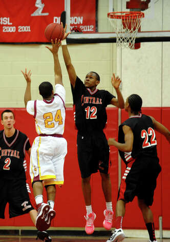 Central's #12 Rickardo Grant defends against a shot by St. Joseph's #24 Judeneick Florian, during FCIAC boys basketball semifinals action in Fairfield, Conn. on Tuesday February 26, 2013. Photo: Christian Abraham / Connecticut Post
